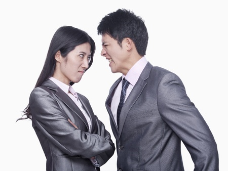Businessman and businesswoman angry at each other Stock Photo - 21369918