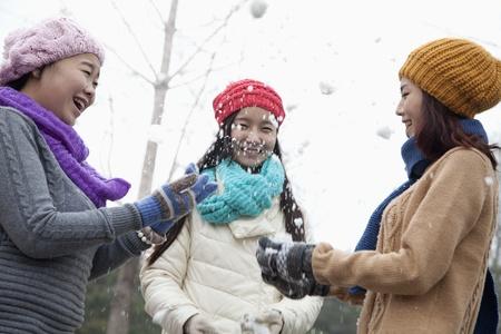 Friends Having a Snowball Fight photo