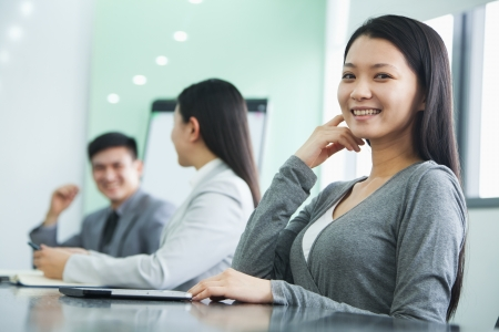 business casual: Businesswoman Looking At Camera in a Meeting