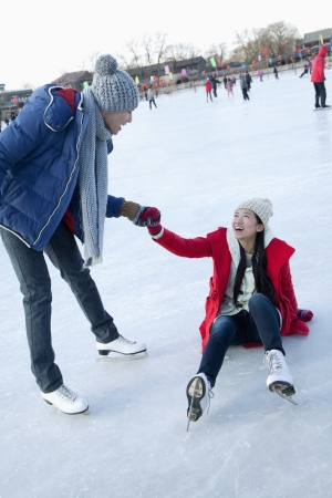 Young couple at ice rink photo