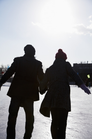 ice rink: Young couple at ice rink Stock Photo