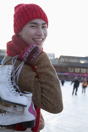 ice rink: Young man on ice rink