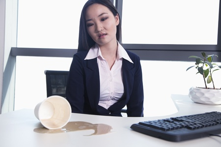 spilling: Businesswoman spilling coffee