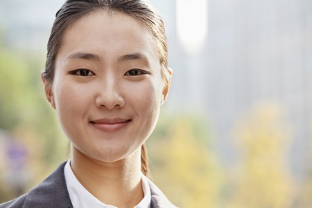 chinese woman: Portrait of young businesswoman smiling outside in Beijing