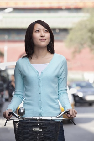 Young Woman on a Bicycle in Beijing photo