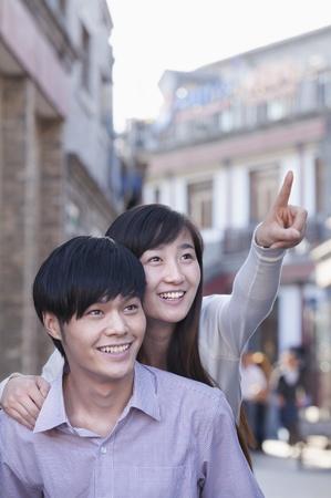 heterosexual: Young Heterosexual Couple Pointing Outdoors in Beijing Stock Photo