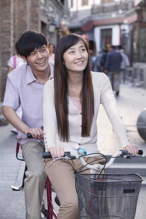 tandem bicycle: Young Heterosexual Couple on a Tandem Bicycle in Beijing