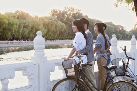 Two couples by HouHai Lake with Bicycles in Beijing photo
