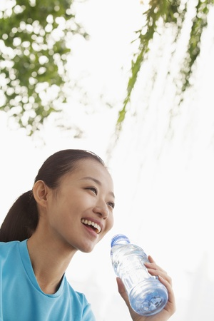 water activity: Young woman drinking water