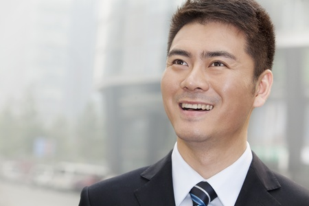 30 34 years: Young Businessman Smiling and Looking Away, Portrait Stock Photo