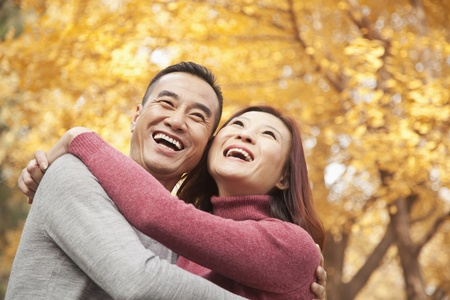 Mature Couple Embracing in Park photo
