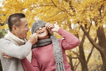 Mature Couple Enjoying a Park in Autumn photo