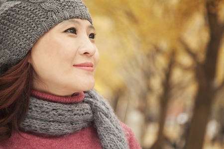 mature people: Mature Woman Enjoying a Park in Autumn Stock Photo