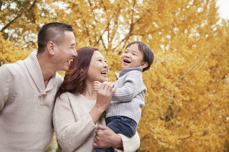 recreational area: Family Enjoying a Park in Autumn Stock Photo