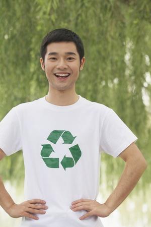 environmental issues: Young Man Smiling, Recycling Symbol, Beijing