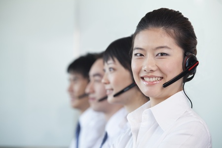 and white collar workers: White Collar Workers in a row with headsets Stock Photo