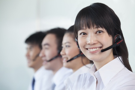 white collar workers: White Collar workers in a row with headsets
