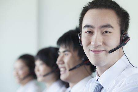 and white collar workers: White Collar workers in a row with headsets