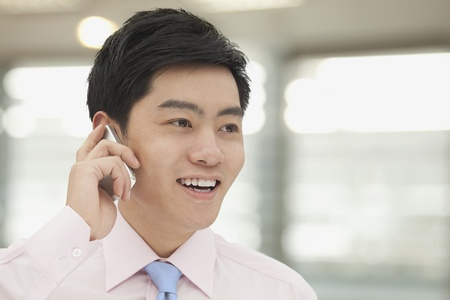button down shirt: Young Businessman in pink button down shirt on the phone, Beijing, China