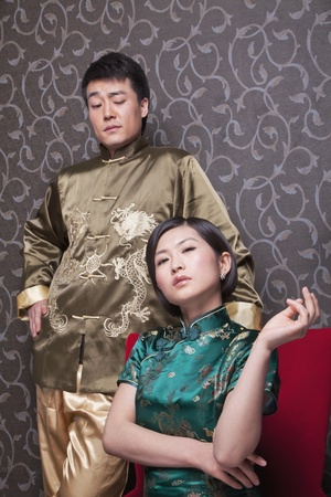 battle of the sexes: Portrait of Cool Couple in Chinese Traditional Clothing