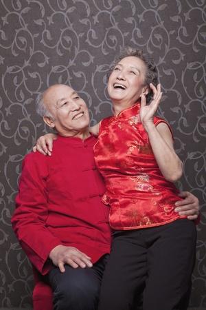 traditional clothing: Senior Chinese Couple Laughing in Traditional Clothing