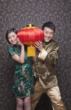 chinese lantern: Young Couple Holding Chinese Lantern in Traditional Clothing