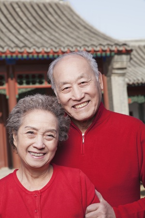 Senior Chinese Couple in Traditional Courtyard