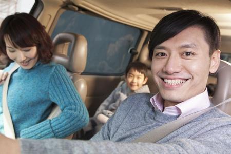 Family sitting in car, Beijing  Reklamní fotografie