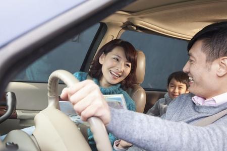 Family sitting in car, Beijing  Foto de archivo