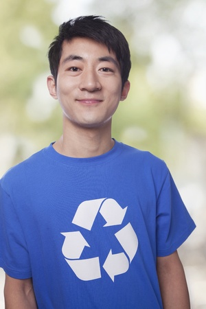 environmental issues: Portrait of young man with recycling t-shirt