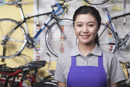 large group of business people: Portrait of young female mechanic in bicycle store, Beijing