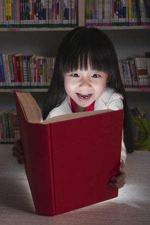 Girl Surprised By Glowing Book photo
