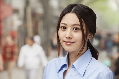 incidental people: Young Woman smiling and looking at camera