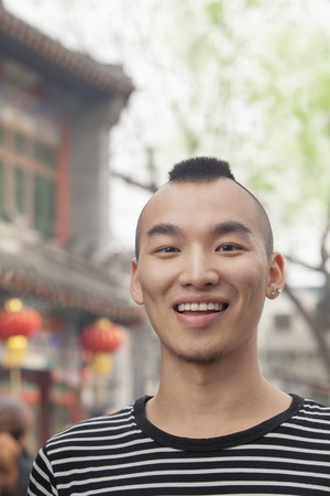 mohawk: Young Man with Mohawk haircut smiling looking at camera