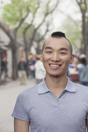 incidental people: Young Man with Mohawk haircut smiling looking at camera