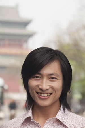 incidental people: Young Man smiling looking at camera