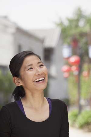 incidental people: Young Woman smiling and looking Away Stock Photo