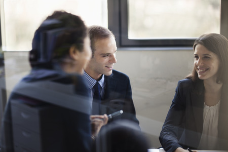 business strategy: Three business people sitting and discussing at a business meeting Stock Photo
