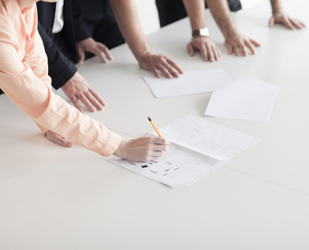 adult  body writing: Close up of arms and hands of business people in the office having a business meeting