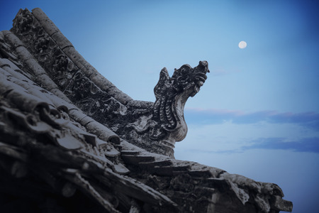 Close-up of carvings on the roof of the pagoda, dusk, Shanxi Province, China