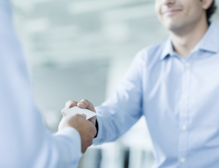 Close up of two businessmen exchanging business cards Stock Photo