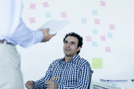 Two businessmen sitting and talking in the office photo