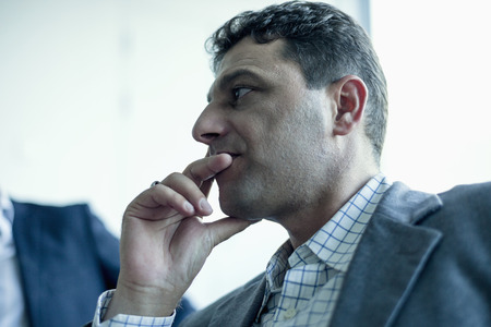 Businessman listening in a business meeting photo