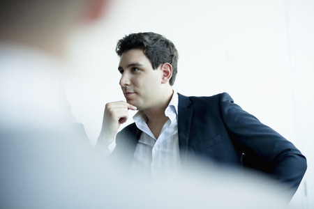 business focus: Young businessman listening in a business meeting Stock Photo