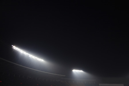 sports venue: Stadium floodlights at night time, Beijing, China Stock Photo