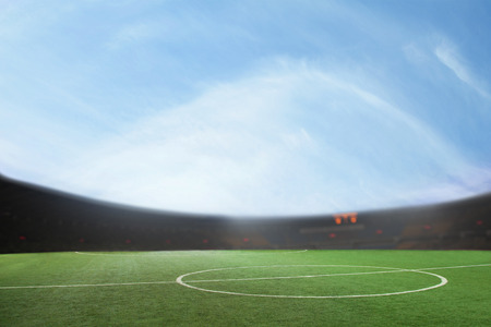 digital composite: Digital composite of soccer field and blue sky Stock Photo