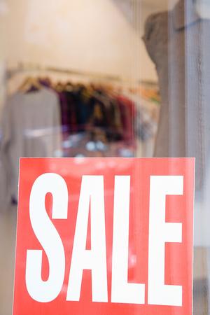 shop window: Sale sign in shop window