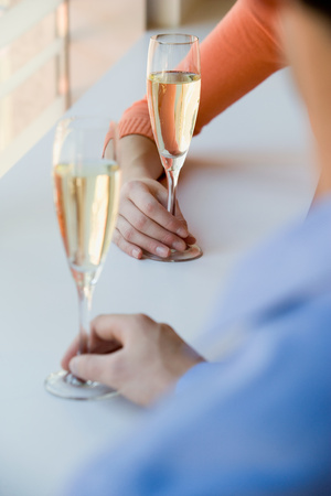 grown ups: A couple having champagne
