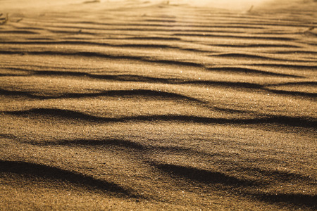 flare up: Surface level shot of the desert and the wind pattern on the sand Stock Photo
