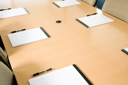 tomes: Notepads on conference table